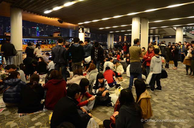 Crowds waiting along Victoria Harbor Hong Kong for the New Year Fireworks
